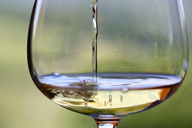 White wine in wine glass near apartments near Widener University.