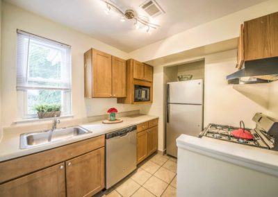 Large kitchen with wooden cabinets and updated appliances at apartment in Boothwyn PA