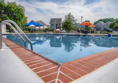 Large swimming pool with sundeck at Boothwyn, PA apartment community